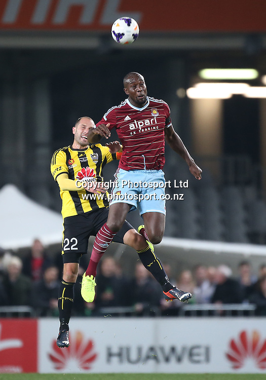 Carlton Cole of West Ham vs Andrew Durante of the Wellington Phoenix during the Wellington Phoenix vs West Ham United football match played at Eden Park in Auckland on 23 July 2014. The Phoenix won the match 2-1. <br /> Credit; Peter Meecham/ www.photosport.co.nz