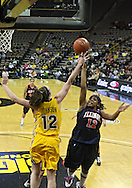 February 24 2011: Iowa Hawkeyes center Morgan Johnson (12) blocks a shot by Illinois Fighting Illini guard Lydia McCully (12) during the first half of an NCAA women's college basketball game at Carver-Hawkeye Arena in Iowa City, Iowa on February 24, 2011. Iowa defeated Illinois 83-64.