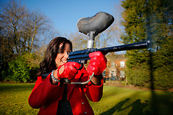 UK ENGLAND PRESTON 10FEB10 - Miss England, Katrina Hodge (22) performs a publicity stunt with a paintball gun at Rock FM in Preston, Lancashire. Katrina Hodge is on a week-long tour to promote the beauty pageant and careers at the armed forces in northern England...jre/Photo by Jiri Rezac..© Jiri Rezac 2010