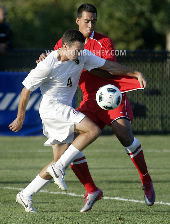 Army's Carson McReynolds tries to control the ball in front of Marist's Gerry Ceja during a game at West Point on Friday, Aug. 26, 2011.