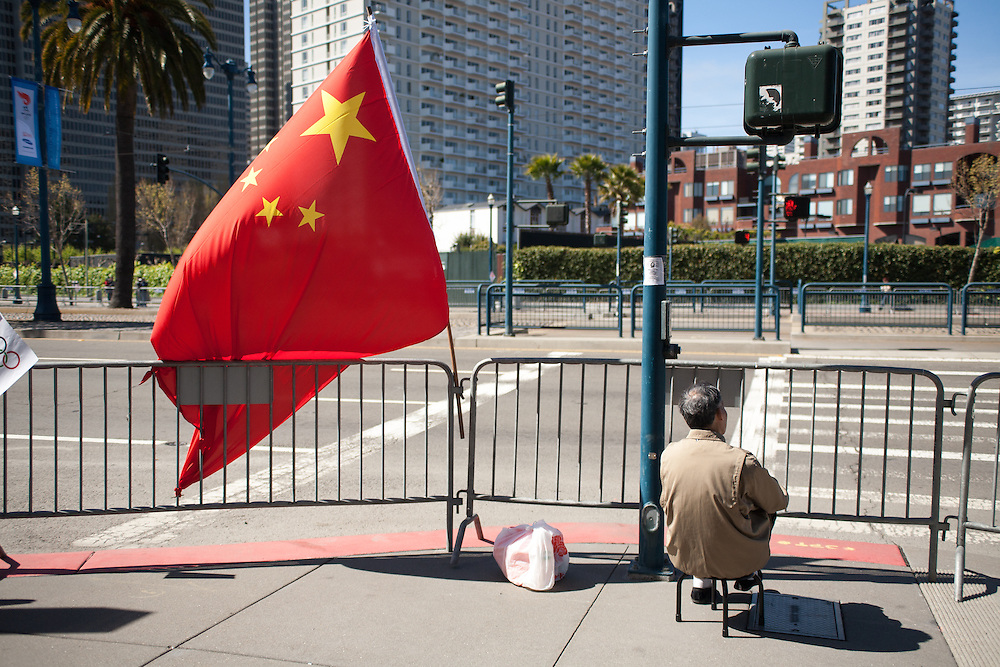 Chinese American waits for Olympic Torch to Pass