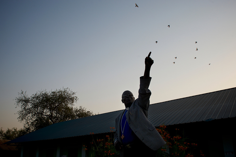 A priest addresses an audience of voters outside a polling station in central Juba, ahead of the seven day referendum for the independence of Southern Sudan.