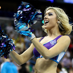 April 6, 2011; New Orleans, LA, USA; A New Orleans Hornets Honeybees dancers performs during the second half of a game against the Houston Rockets at the New Orleans Arena.   Mandatory Credit: Derick E. Hingle-US PRESSWIRE