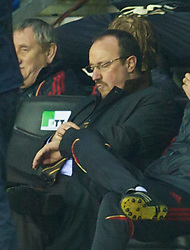 WIGAN, ENGLAND - Monday, March 8, 2010: Liverpool's manager Rafael Benitez looks dejected as his side suffer an embrassing defeat to lowly Wigan Athletic during the Premiership match at the DW Stadium. (Photo by David Rawcliffe/Propaganda)