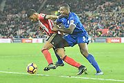 Patrick van (3) Aanholt Sunderland AFC defender and Leicester City's defender Wes Morgan (5) during the Premier League match between Sunderland and Leicester City at the Stadium Of Light, Sunderland, England on 3 December 2016. Photo by Ian Lyall.