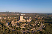 Ulldecona Castle, aerial view, at Ulldecona, Catalonia, Spain. The castle was built as an Andalusian fort under the Moors 8th - 11th centuries, then owned by the Montcada family of Tortosa, who in 1148 gave it to the Order of Knights of the Hospital of Saint John of Jerusalem, when it became a Christian castle. A 16th century church, a 12th century circular watch tower and a 13th century square keep remain, built on top of the original Arabic fort and earlier Iberian settlements. Picture by Manuel Cohen