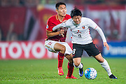 GUANGZHOU, CHINA - MARCH 16:  Muto Yuki of Urawa Red Diamonds (R) being followed by Wang Sangyuan of Guangzhou Evergrande (L) during the AFC CHampions League match between Guangzhou Evergrande and Urawa Red Diamonds on March 16, 2016 in Guangzhou, China.  (Photo by Aitor Alcalde Colomer/Getty Images)