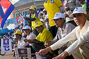 Men with flags and banners are attend an election campaign rally for opposing CNRP led by Sam Rainsy in Kampong Cham, Cambodia.