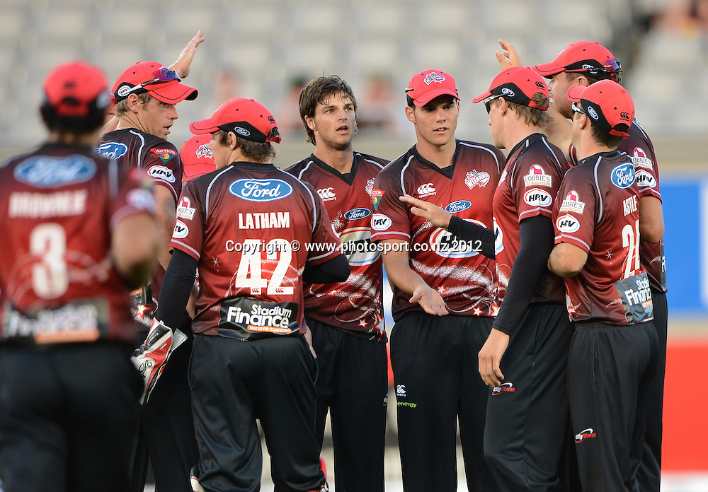 Canterbury players celebrate a wicket during the HRV Cup Twenty20 Cricket match between Auckland Aces and Canterbury Wizards at Eden Park on Friday 21 December 2012. Photo: Andrew Cornaga/Photosport.co.nz