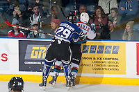 KELOWNA, CANADA - MARCH 11: Chaz Reddekopp #29 of Victoria Royals checks Tyson Baillie #24 of Kelowna Rockets in to the boards  on March 11, 2015 at Prospera Place in Kelowna, British Columbia, Canada.  (Photo by Marissa Baecker/Shoot the Breeze)  *** Local Caption *** Tyson Baillie; Chaz Reddekopp;