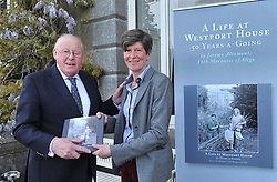 Liam Lyons and Sheelyn Browne with a copy of Lord Altamounts memoir 'A Life at Westport House 50 Years A Going' at the launch that took place last week.<br /> Pic Conor McKeown