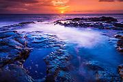 Sunset and tide pool above the Pacific, Kailua-Kona, Hawaii USA