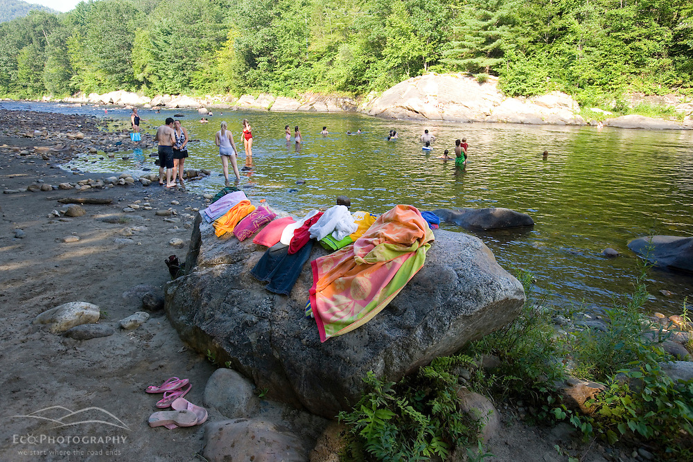 Locals enjoying a swimmg hole on the West River in Dummerston, Vermont.