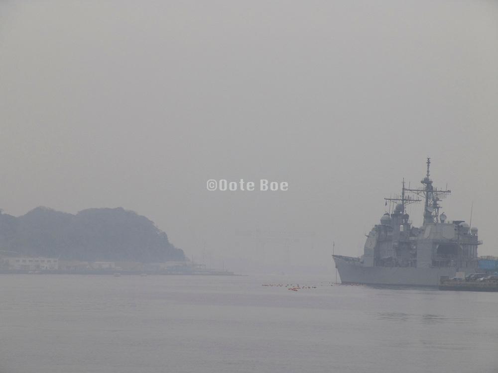 US military boat in fog harbor Yokosuka Japan