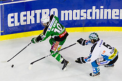 Brock McBride (HDD Tilia Olimpija, #10) and Franklin MacDonald (EHC Liwest Linz, #5) during ice-hockey match between HDD Tilia Olimpija and EHC Liwest Black Wings Linz at second match in Semifinal  of EBEL league, on March 8, 2012 at Hala Tivoli, Ljubljana, Slovenia. (Photo By Matic Klansek Velej / Sportida)