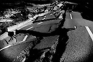 Route 6 completely failed and crumbled away during the massive 11 March 2011 earthquake at the main southern police checkpoint for the 20 km (12.4 miles) nuclear no-entry zone.  Hironomachi, Fukushima Prefecture, Japan.