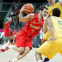 31 July 2012: Spain Jose Calderon drives past Australia David Andersen during the 82-70 Spain victory over Australia, during the men's basketball preliminary, at the Basketball Arena, in London, Great Britain.