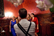 A group of girlfriends being photographed with the bride (not seen) at Hanne and Paul's wedding in Baerum, Norway