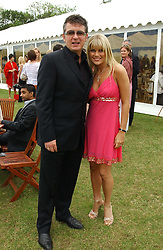SHANE RITCHIE and girlfriend CHRISTIE GODDARD at the Kuoni World Class Polo Day held at Hurtwood Park Polo Club, Surrey on 29th May 2005.<br />