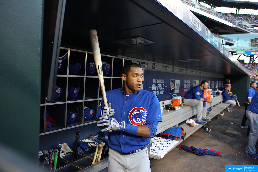 NEW YORK, NEW YORK - July 02: Addison Russell #27 of the Chicago Cubs in the dugout preparing to bat during the Chicago Cubs Vs New York Mets regular season MLB game at Citi Field on July 02, 2016 in New York City. (Photo by Tim Clayton/Corbis via Getty Images)