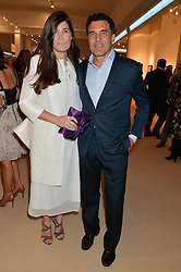 ELIZABETH SALTZMAN and ANDRE BALAZS at the Masterpiece Marie Curie Party supported by Jeager-LeCoultre held at the South Grounds of The Royal Hospital Chelsea, London on 30th June 2014.