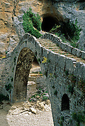 An arched stone bridge, 300 years old, crosses a ravine near Kipi, Zagoria, Epirus/Epiros, Greece, Europe. Zagori (Greek: ) is a region and a municipality in the Pindus mountains in northwestern Greece. Zagori contains 45 villages collectively known as Zagoria (Zagorochoria or Zagorohoria).