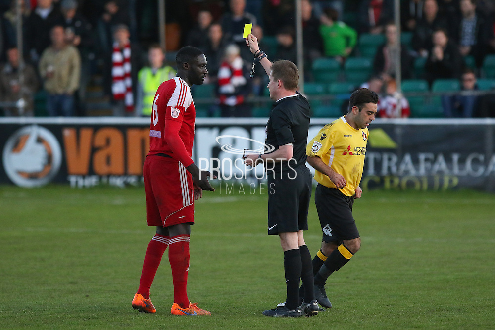 Referee Andrew Laver shows yellow card to Chris M'Boungou during the National League South Play Off 1st Leg match between Whitehawk FC and Ebbsfleet United at the Enclosed Ground, Whitehawk, United Kingdom on 4 May 2016. Photo by Phil Duncan.