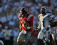 Ole Miss quarterback Bo Wallace (14) runs 25 yards for a first quarter touchdown at Vaught-Hemingway Stadium in Oxford, Miss. on Saturday, September 1, 2012.