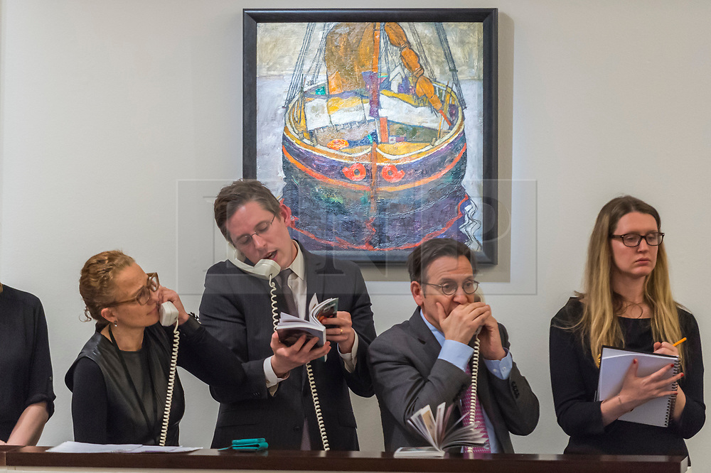 © Licensed to London News Pictures. 26/02/2019. LONDON, UK. Sotheby's staff take telephone bids in front of ''Triestiner Fischerboot (Trieste Fishing Boat)'' by Egon Schiele, (Est. £6,000,000 - 8,000,000) which sold for a hammer price of £9,200,000 at Sotheby's Impressionist, Modern and Surrealist Art Evening Sale in New Bond Street.  Photo credit: Stephen Chung/LNP