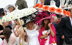 Racegoers at Ladies Day at Glorious Goodwood, Thursday, 2nd August 2012  Photo by: Stephen Lock / i-Images