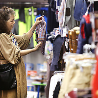 Adam Robison | BUY AT PHOTOS.DJOURNAL.COM<br /> Brenda Owens, of Pontotoc, shops over the clothing section at The Corner Shoe Store Friday afternoon in Tupelo.