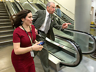 Sen. Chuck Grassley (R-Iowa) (right) runs with Washington Post reporter Karoun Demirjian as he rushes to the Senate Subway after voting on the Senate floor during the fourth day of hearings before the Senate Judiciary Committee for Neil Gorsuch to become an Associate Justice of the US Supreme Court in the U.S. Capitol Building in Washington, D.C. on Thursday, Mar. 23, 2017.