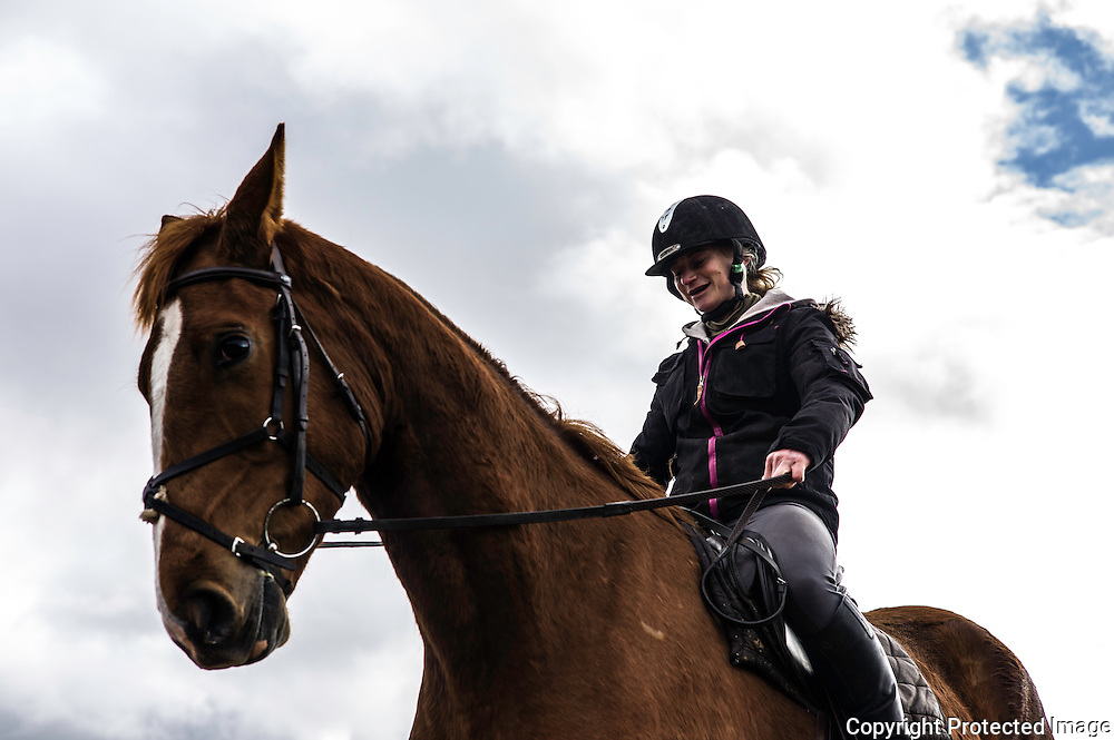Ancrum, Jedburgh, Scottish Borders, UK. 6th April 2016. Four Star eventer Emily Galbraith schools a young horse on a changeable spring day in the Borders. © Chris Strickland / Alamy Live News