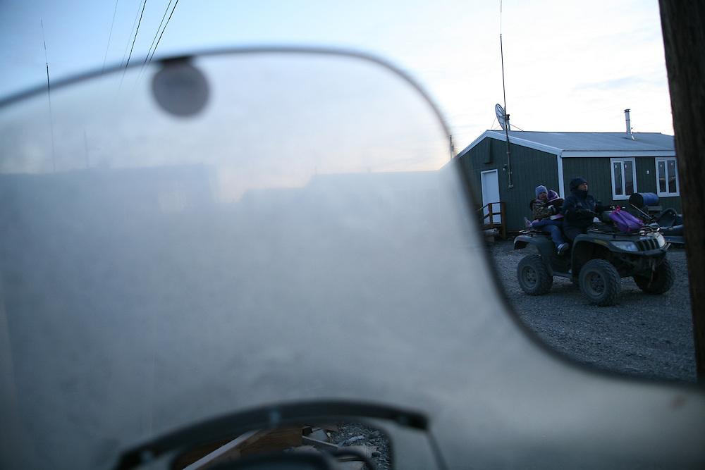 Family driving by in Noatak, Alaska. 2009