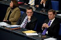 """19 MAY 2010, BERLIN/GERMANY:<br /> Sabine Leutheusser-Schnarrenberger (L), FDP, Bundesjustizministerin, Thomas de Maiziere (M), CDU, Bundesinnenminister, und Guido Westerwelle (R), FDP, Bundesaussenminister, waehrend der Bundestagsdebatte zur Regierungserklaerung der Bundeskanzlerin """"Maßnahmen zur Stabilisierung des Euro"""", Plenum, Deutscher Bundestag<br /> IMAGE: 20100519-01-026<br /> KEYWORDS: Thomas de Maiziére"""