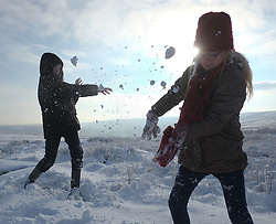 &copy; Licensed to London News Pictures. <br /> 27/12/2014. <br /> <br /> Castleton, United Kingdom.<br /> <br /> William Carter (L), 11 from Keldholme has a snowball fight with his sister Eleanor, 9 on the North Yorkshire Moors near Castleton after overnight snowfall caused disruption in some parts of the country.<br /> <br /> Photo credit : Ian Forsyth/LNP