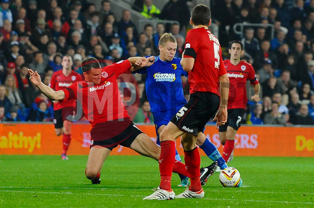 Watford Forward Matej Vydra (CZE) strikes as Cardiff Defender Mark Hudson (ENG) blocks during the first half of the match - Photo mandatory by-line: Rogan Thomson/JMP - Tel: Mobile: 07966 386802 23/10/2012 - SPORT - FOOTBALL - Cardiff City Stadium - Cardiff. Cardiff City v Watford - Football League Championship
