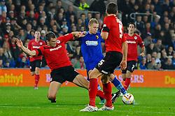Watford Forward Matej Vydra (CZE) strikes as Cardiff Defender Mark Hudson (ENG) blocks during the first half of the match - Photo mandatory by-line: Rogan Thomson/JMP - Tel: Mobile: 07966 386802 23/10/2012 - SPORT - FOOTBALL - Cardiff City Stadium - Cardiff. Cardiff City v Watford - Football League Championship