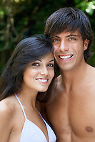 Young couple in swimwear in forest portrait