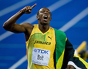 amaica's Usain Bolt wins the men's 100m final race of the 2009 IAAF Athletics World Championships ahead of US Tyson Gay and Jamaica's Asafa Powell on August 16, 2009 in Berlin. Jamaican Usain Bolt set a new world record of 9.58 seconds in winning the final of the men's 100m at the World Athletics Championships.