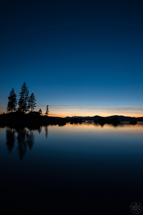 """""""Sunset at Lake Tahoe 29"""" - A silhouette of trees and boulders photographed from the shore of Sand Harbor."""