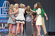 Aug 3, 2019; Canton, OH, USA; Members of the Bowlen family and presenter Steve Antonopulos unveil the bust of the late Pat Bowlen during the Pro Football Hall of Fame Enshrinement at Tom Benson Hall of Fame Stadium. (Robin Alam/Image of Sport)