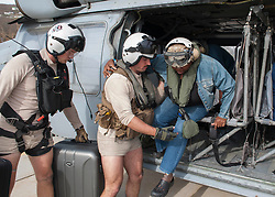 170909-N-NM806-310 <br /> ST. THOMAS, U.S. Virgin Islands (Sept. 9, 2017) Naval Aircrewman (Helicopter) 2nd Class Nicholas Glass and Naval Aircrewman (Helicopter) 2nd Class Andy Blessing, both assigned to the amphibious assault ship USS Wasp (LHD 1), prepare a resident for evacuation as part of first response efforts to the U.S. Virgin Islands in the wake of Hurricane Irma. The Department of Defense is supporting the Federal Emergency Management Agency, the lead federal agency, in helping those affected by Hurricane Irma to minimize suffering and is one component of the overall whole-of-government response effort. (U.S. Navy photo by Mass Communication Specialist Seaman Taylor King/Released)