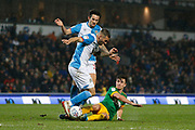 Bradley Johnson of Blackburn Rovers  is tackled by Joe Rafferty of Preston North End  during the EFL Sky Bet Championship match between Blackburn Rovers and Preston North End at Ewood Park, Blackburn, England on 11 January 2020.