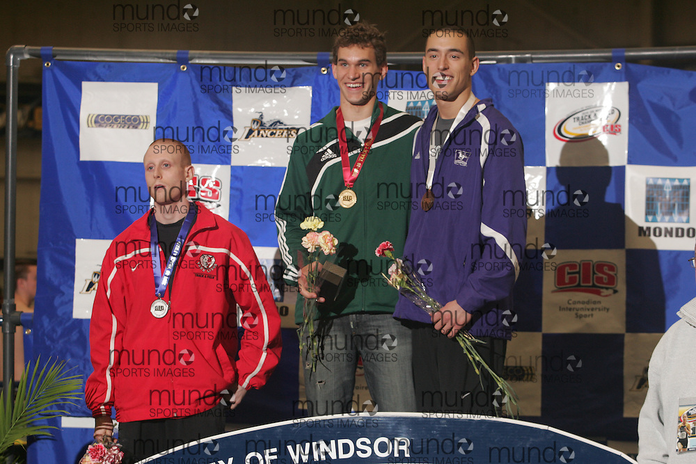 (Windsor, Ontario---12 March 2010) .Regina's Justin Baker, center,  Western's Matt Brisson, right, and York's Chris Theriau receive their medal in the 60m hurdles for a photo at the 2010 Canadian Interuniversity Sport Track and Field Championships at the St. Denis Center. Photograph copyright Geoff Robins/Mundo Sport Images. www.mundosportimages.com