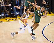 Golden State Warriors forward Andre Iguodala (9) attacks the basket against the Utah Jazz at Oracle Arena in Oakland, Calif., on December 20, 2016. (Stan Olszewski/Special to S.F. Examiner)