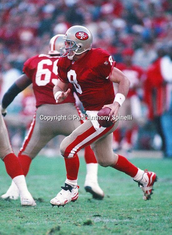 San Francisco 49ers quarterback Steve Young (8) runs the ball during the NFL NFC Divisional Playoff football game against the Green Bay Packers on Jan. 6, 1996 in San Francisco. The Packers won the game 27-17. (©Paul Anthony Spinelli)