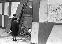 An elderly couple pictured on the street looking at the Wood Quay building site in the Liberties in Dublin, May 14 1975. <br /> (Part of the Independent Ireland Newspapers/NLI Collection)