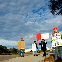 GLENN DUKE (far right) of Little River, protests as part of the 'Occupy' movement outside the South Carolina Tea Party Convention.  A presidential debate will be held tonight while the primary is on 21 January.