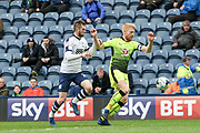 Preston striker Tom Barkuizen chases Reading Defender Paul McShane during the EFL Sky Bet Championship match between Preston North End and Reading at Deepdale, Preston, England on 11 March 2017. Photo by Pete Burns.